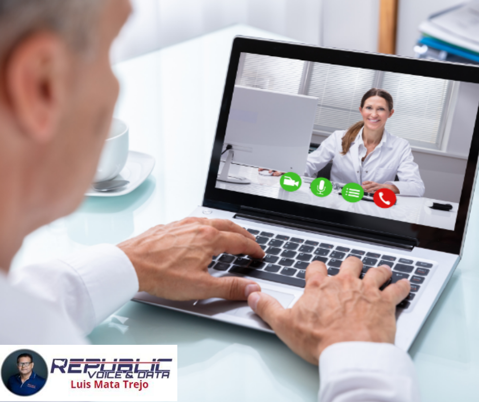Man in white dress shirt on laptop video call with doctor