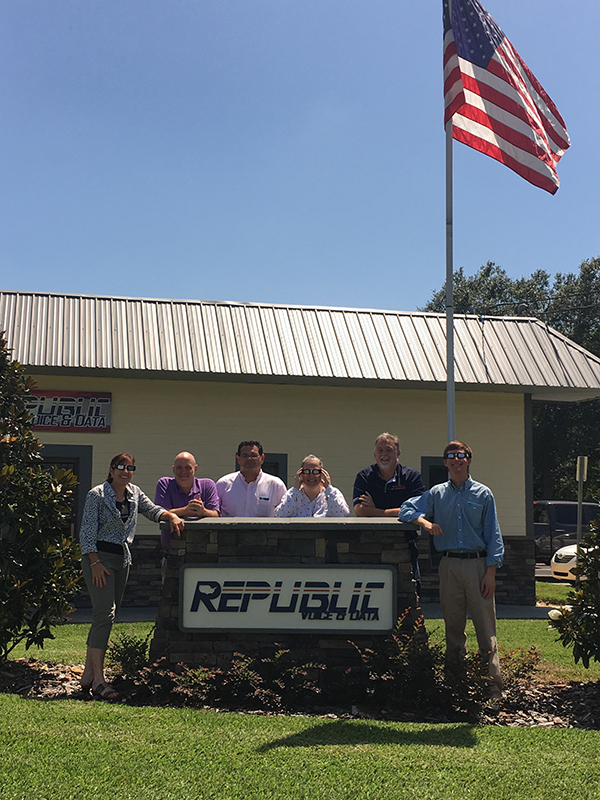 The republic Voice & Data team gathered together outside the office for the eclipse viewing